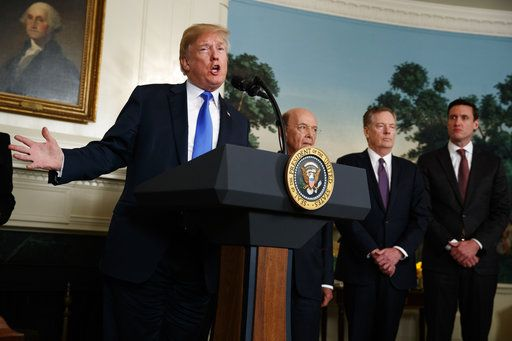 President Donald Trump speaks before he signs a presidential memorandum imposing tariffs and investment restrictions on China in the Diplomatic Reception Room of the White House, Thursday, March 22, 2018, in Washington. Secretary of Commerce Wilbur Ross, United States Trade Representative Robert Lighthizer, and White House homeland security adviser Tom Bossert listen.