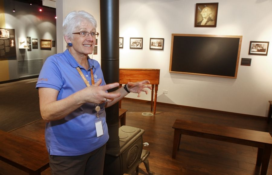 Nan Buckardt, director of education for the Lake County Forest Preserve District, describes the one-room schoolhouse exhibit at the new Bess Bower Dunn Museum.