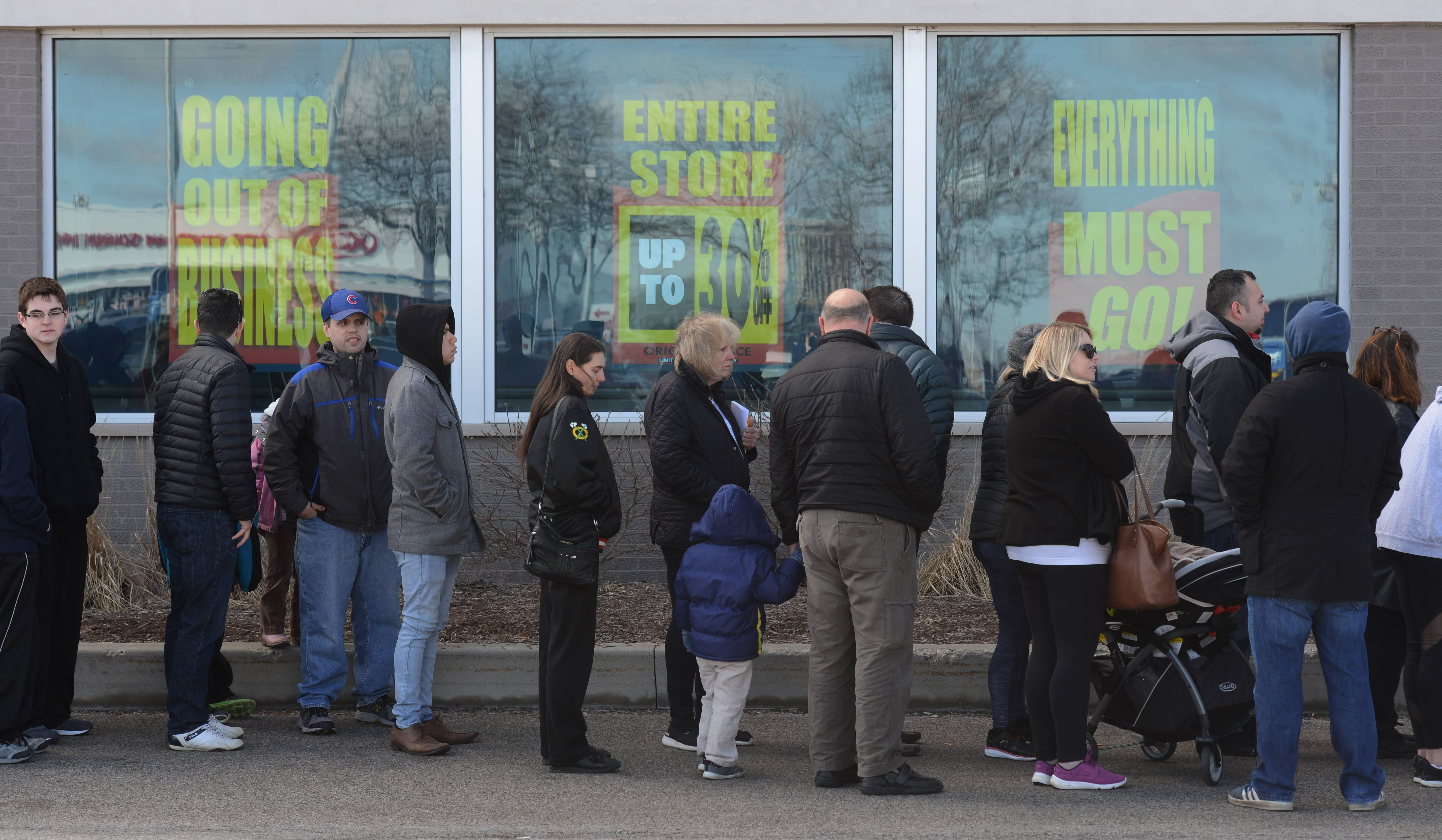 Customers Line Up For Toys R Us Liquidation Sale