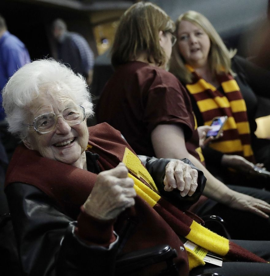Sister Jean Dolores Schmidt sits with other Loyola-Chicago fans during the first half of a regional semifinal NCAA college basketball game against Nevada, Thursday, March 22, 2018, in Atlanta. She's become the famous face of the team, and now there's a music video honoring her.