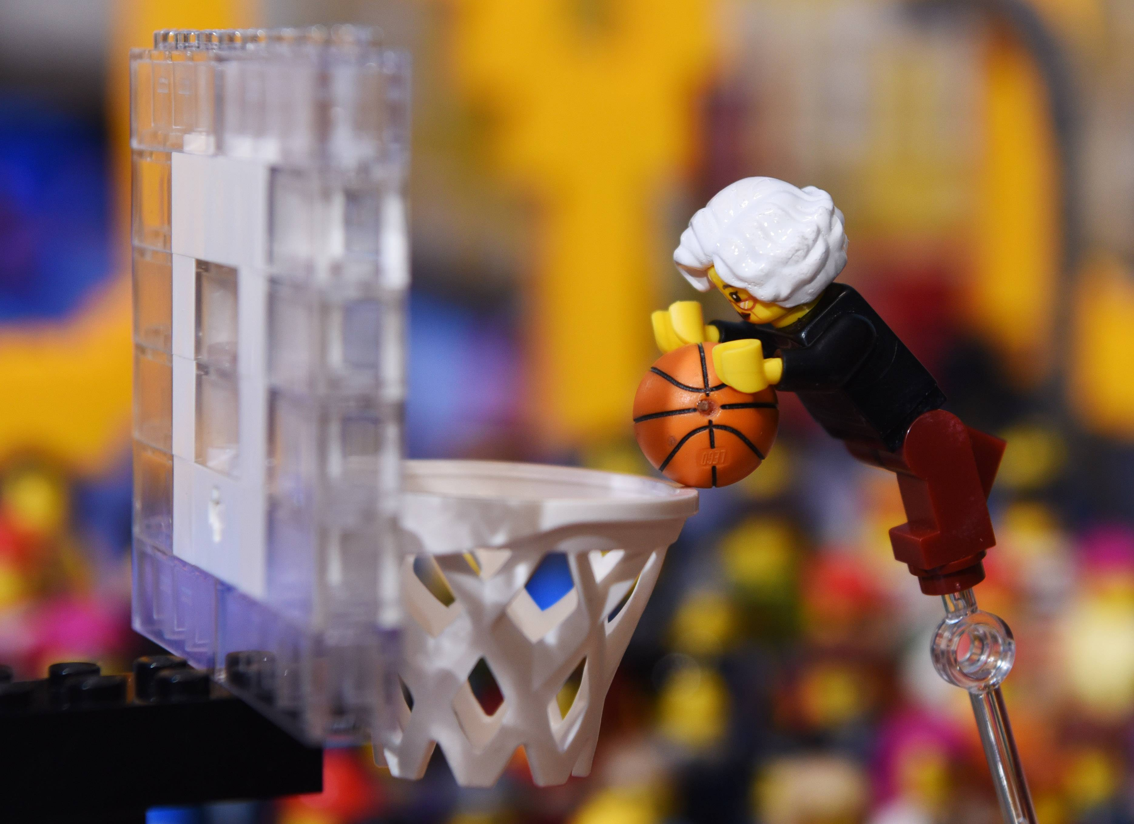 A minifigure of Loyola University's chaplain, 98-year-old Sister Jean Dolores Schmidt, dunking a basketball on the court is displayed Friday at the Legoland Discovery Center at Streets of Woodfield in Schaumburg.