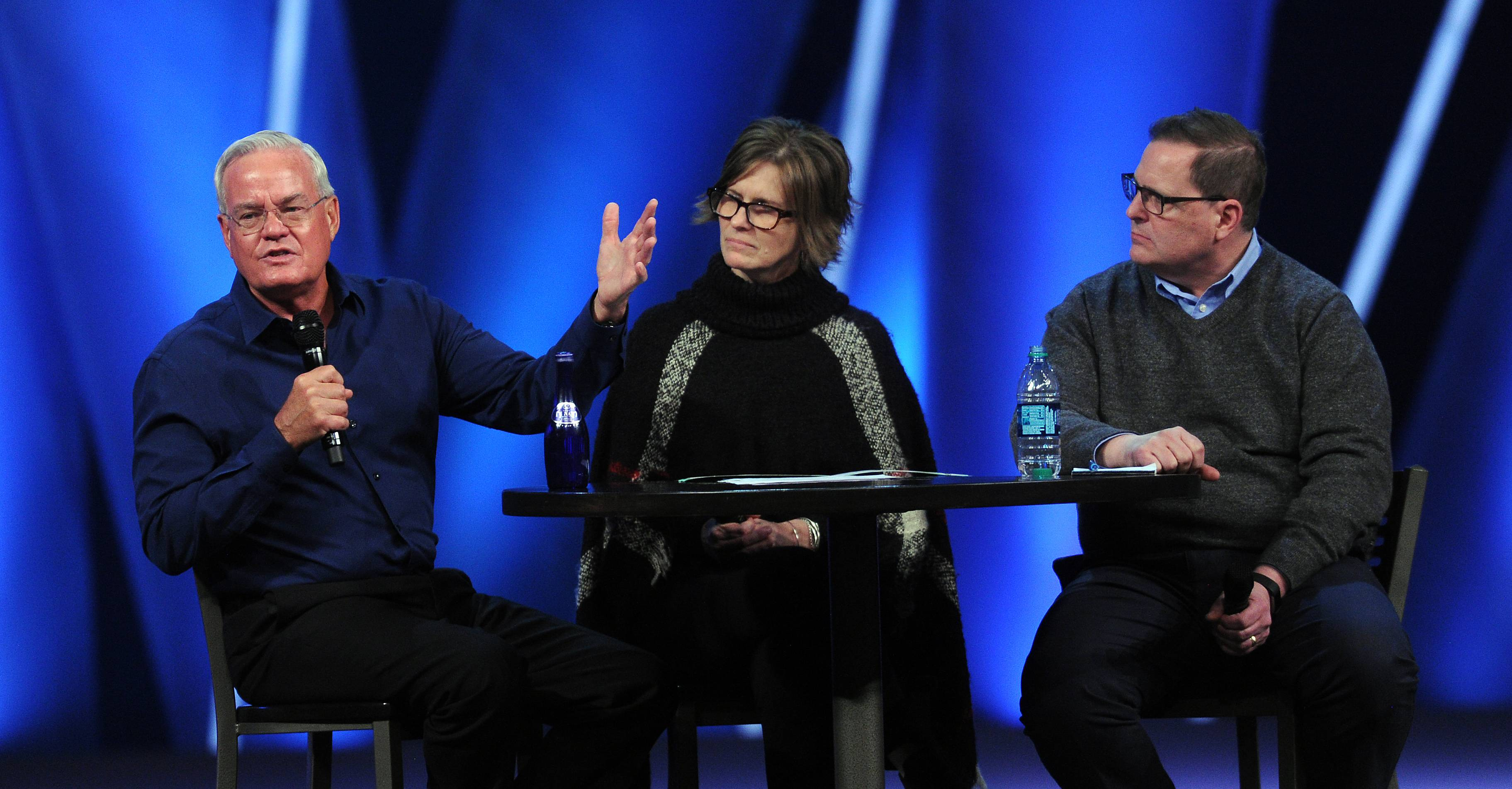 Willow Creek pastor Bill Hybels pleads his case to his congregation Friday about the misconduct allegations involving women as Pam Orr, chairman of the Willow Creek Elder Board, and Rob Campbell, Willow Chicago lead pastor, listen along with thousands of others in South Barrington.