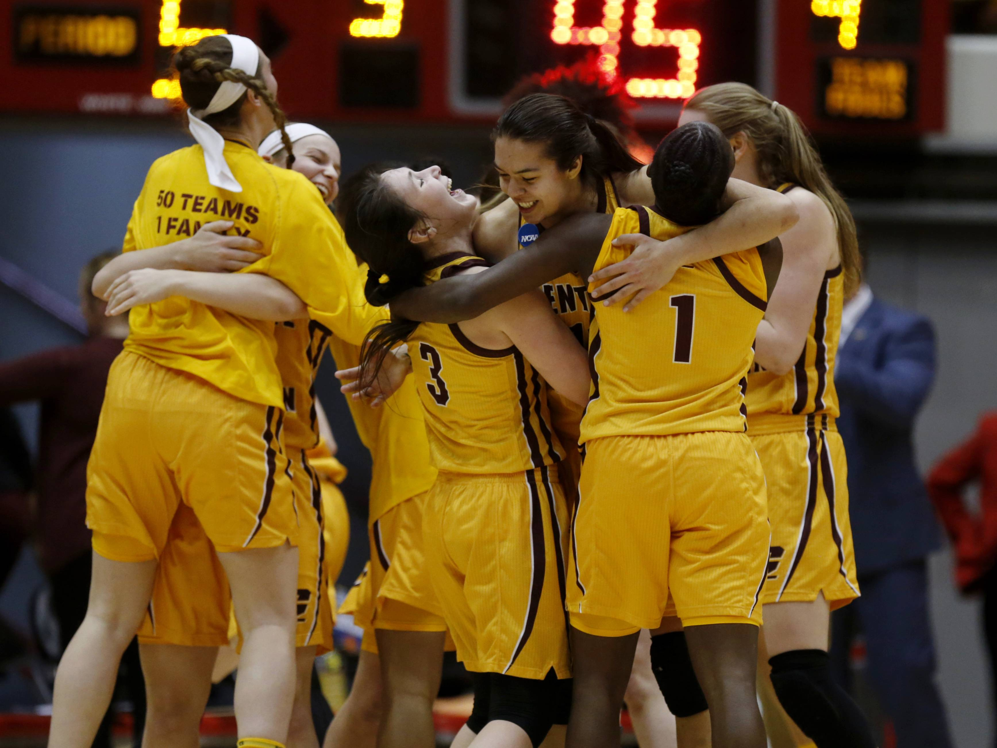 Members of the Central Michigan basketball team celebrate their second-round victory over Ohio State in the NCAA women's college basketball tournament in Columbus, Ohio, on Monday. They face Oregon in Spokane on Saturday.