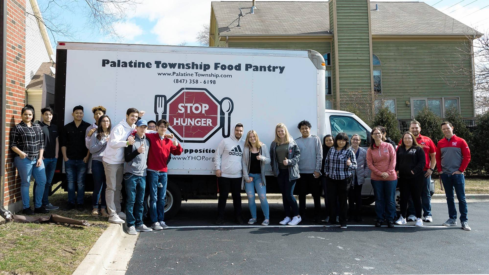Students from Palatine High School's Chemistry of Foods class pose together with the truck for the Palatine Township Food Pantry.