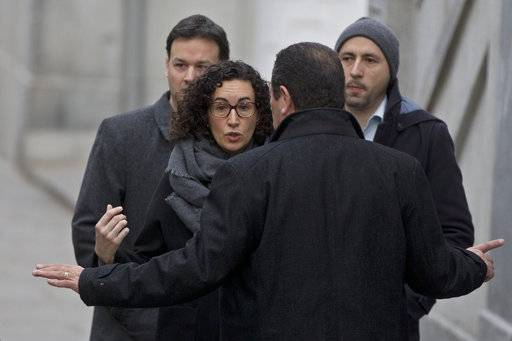"FILE - In this Feb. 19, 2018 file photo, Catalan separatist politician and left-republican ERC party's Marta Rovira arrives at the Supreme court for questioning in Madrid, Spain. Marta Rovira, a prominent Catalan separatist politician has defied a summons to appear in a Spanish court on Friday March 23, 2018 and says in a letter to her party followers that she has chosen ""the path to exile."" Marta Rovira does not say in the letter whether she has left Spain already or where she might go, but six other Catalan politicians, including ousted Catalan president Carles Puigdemont, earlier fled to Brussels. (AP Photo/Paul White, File)"