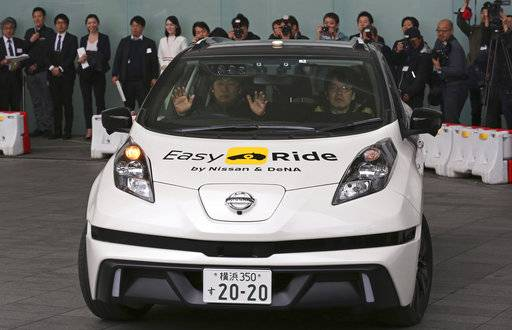 In this Feb. 23, 2018, file photo, Nissan Motor Co.'s Easy Ride robo-vehicle moves during a test ride in Yokohama, near Tokyo. Nissan's chief planning officer said Friday the Japanese automaker does not plan to change its road tests for self-driving vehicles after the recent fatal accident of an Uber autonomous vehicle. (AP Photo/Koji Sasahara, File)