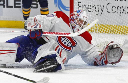 Buffalo Sabres goalie Linus Ullmark (35) stops Montreal Canadiens forward Brendan Gallagher (11) during the first period of an NHL hockey game Friday, March 23, 2018, in Buffalo, N.Y. (AP Photo/Jeffrey T. Barnes)