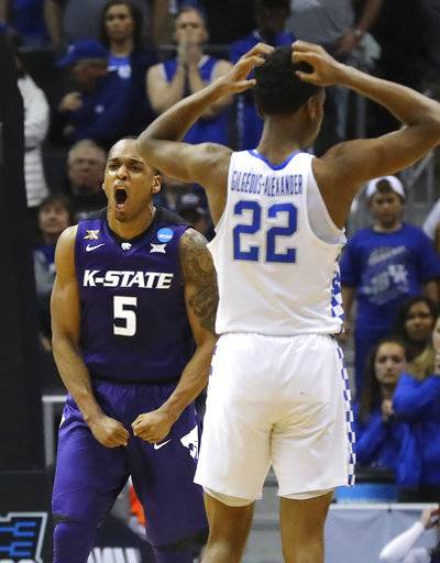 Kansas State guard Barry Brown, Jr., celebrates during the second half of the team's 61-58 victory while Kentucky guard Shai Gilgeous-Alexander reacts during an NCAA men's college basketball tournament regional semifinal early Friday, March 23, 2018, in Atlanta. (Curtis Compton/Atlanta Journal-Constitution via AP)