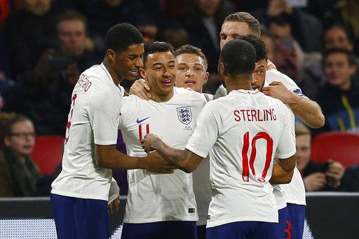 England's Jesse Lingard, second left, celebrates scoring his side's first goal during the international friendly soccer match between the Netherlands and England at the Amsterdam ArenA in Amsterdam, Netherlands, Friday, March 23, 2018. (AP Photo/Peter Dejong)