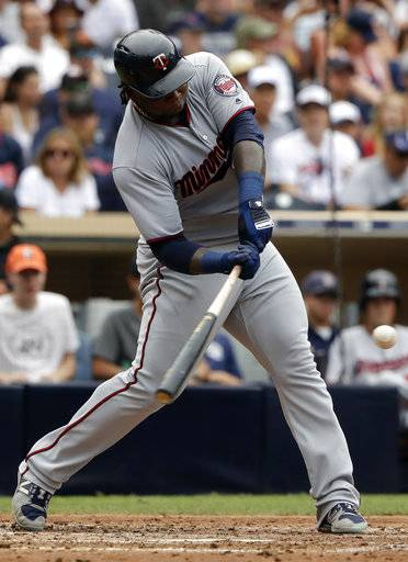 "FILE - In this Aug.2, 2017, file photo, Minnesota Twins' Miguel Sano hits a home run during the sixth inning of a baseball game against the San Diego Padres in San Diego. Sano will not be suspended by Major League Baseball after being accused of assault. The commissioner's office said in a statement on Friday, March 23, 2018, that ""there was insufficient evidence to support a disciplinary determination against Sano, due to conflicting and inconsistent witness accounts and the absence of contemporaneous substantiation.� (AP Photo/Gregory Bull, File)"
