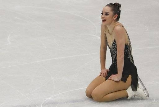 Kaetlyn Osmond of Canada reacts after completing her women's free skating program, at the Figure Skating World Championships in Assago, near Milan, Italy, Friday, March 23, 2018. (AP Photo/Luca Bruno)