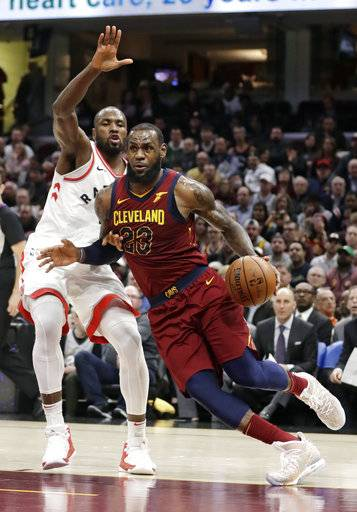Cleveland Cavaliers' LeBron James (23) drives past Toronto Raptors' Serge Ibaka (9) during the second half of an NBA basketball game Wednesday, March 21, 2018, in Cleveland. The Cavaliers won 132-129. (AP Photo/Tony Dejak)