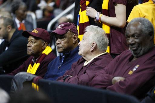 "In this Thursday, March 22, 2018 photo, Loyola-Chicago team members from 1963, Jerry Harkness, Les Hunter, John Egan, Rich Rochelle, from left, watch action during the second half of a regional semifinal NCAA college basketball game, between Loyola-Chicago and Nevada, in Atlanta. ""The '63 team always comes in and always tries to talk to us and give us their support,"" Loyola-Chicago's Marques Townes said Friday, March 23, 2018. (AP Photo/David Goldman)"