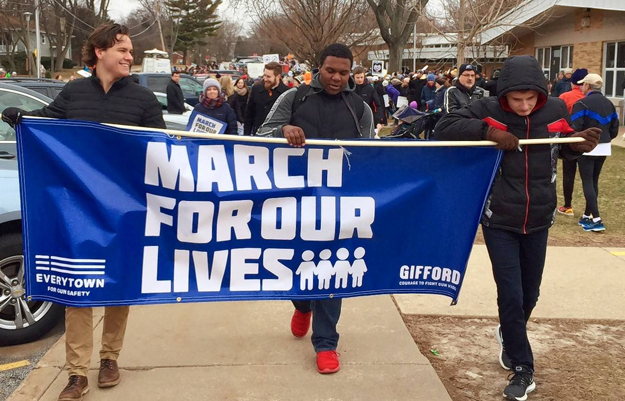 The protest against gun violence Saturday in Glen Ellyn was among many in the Chicago area, with hundreds more around the world.