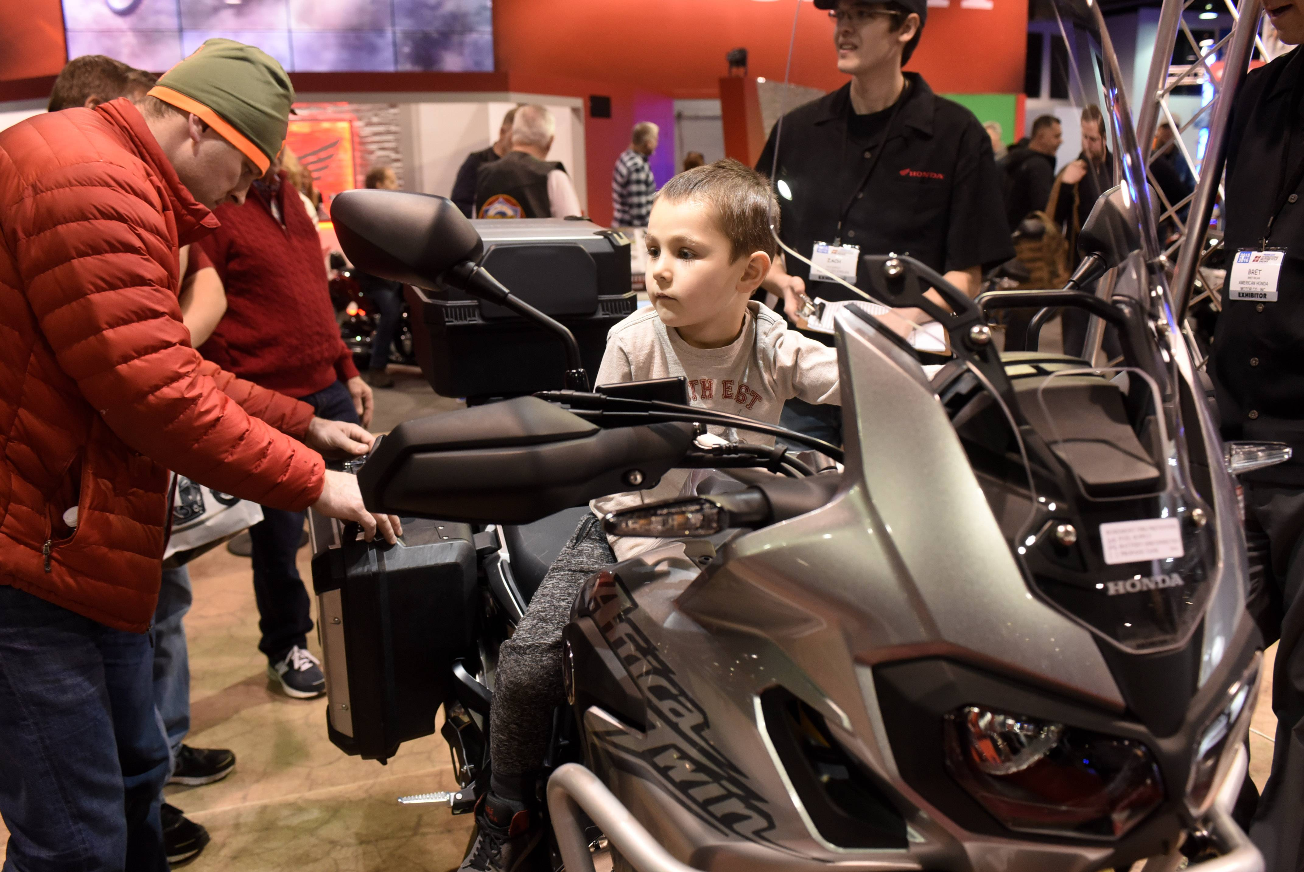 Dreams of buying a new bike can make a grown man feel like a kid again, as witnessed by shoppers at the 2016 Progressive International Motorcycle Show at the Donald Stephens Convention Center in Rosemont.
