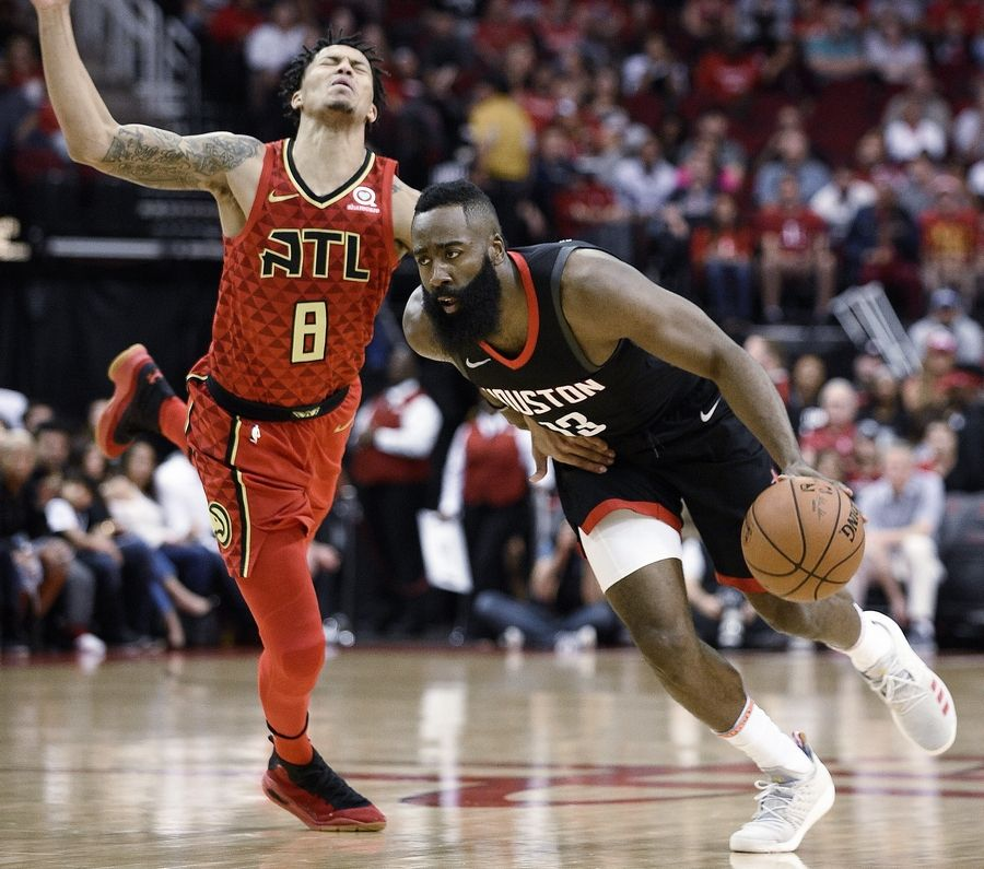 When the Chicago Bulls visit the Houston Rockets on Tuesday, don't expect to see star James Harden, right, on the court. The Rockets announced Monday that Harden and center Clint Capela (not pictured) would sit out vs. the Bulls.