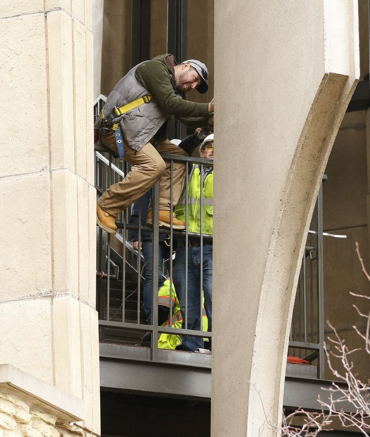 "A worker takes samples Tuesday as part of ""structural forensics"" testing on Moser Tower, which holds the Millennium Carillon in Naperville. Work began Monday and is expected to last 10 to 14 days as the city tries to determine the source of structural problems with the tower and how the issues can be fixed."