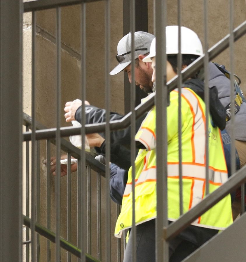 Workers bore and catalog samples Tuesday from Moser Tower in Naperville, which is undergoing 10 to 14 days of in-depth testing to determine the source of structural issues with cracking concrete and corroded steel.
