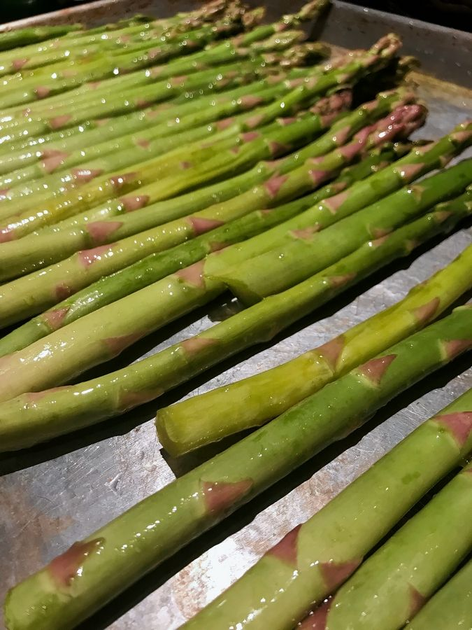 Step one: roast fresh asparagus stalks tossed with a bit of extra-virgin olive oil.