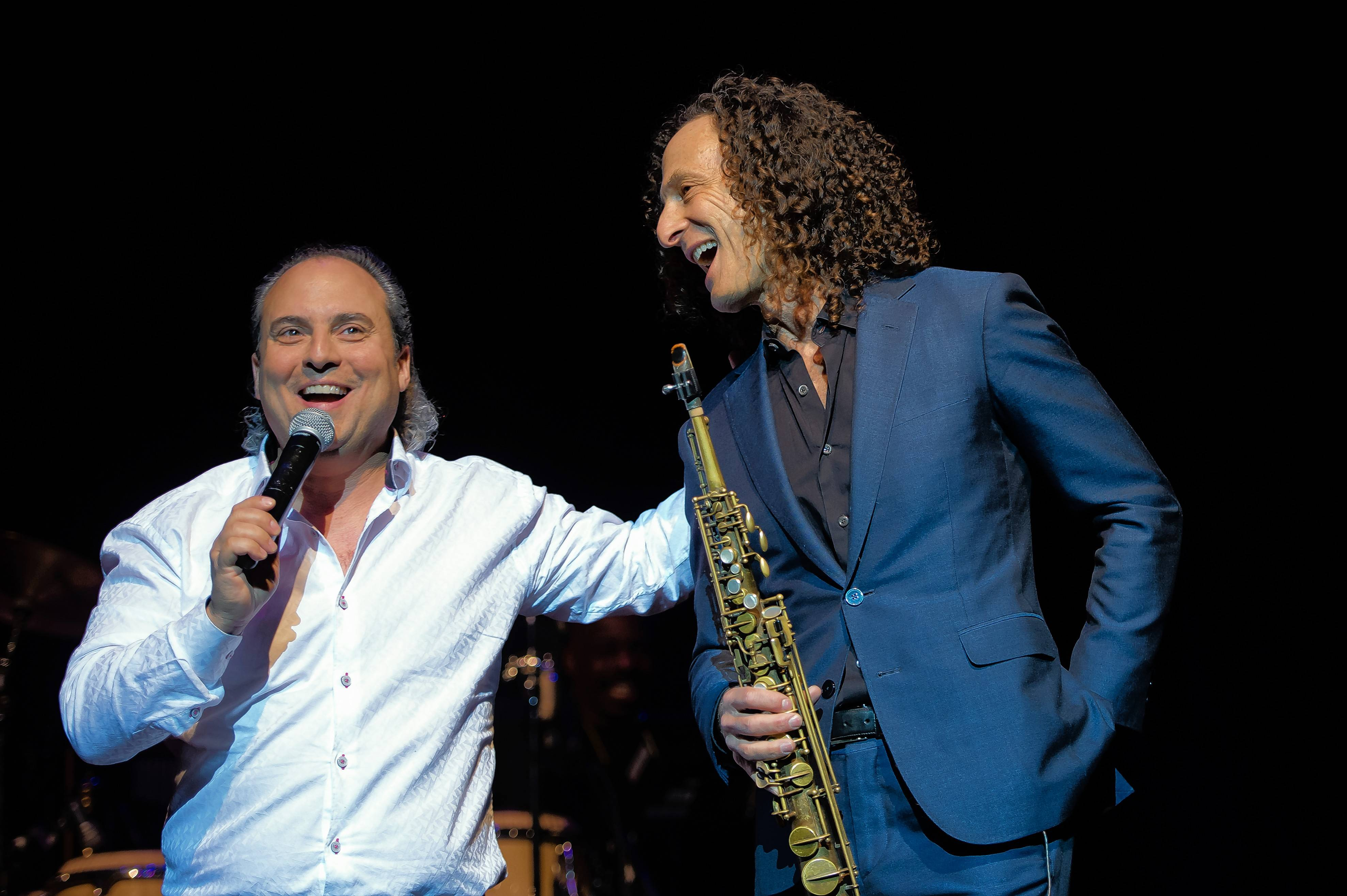 Arcada Theatre owner Ron Onesti, left, introduces Kenny G to the audience before the musician's show last week.