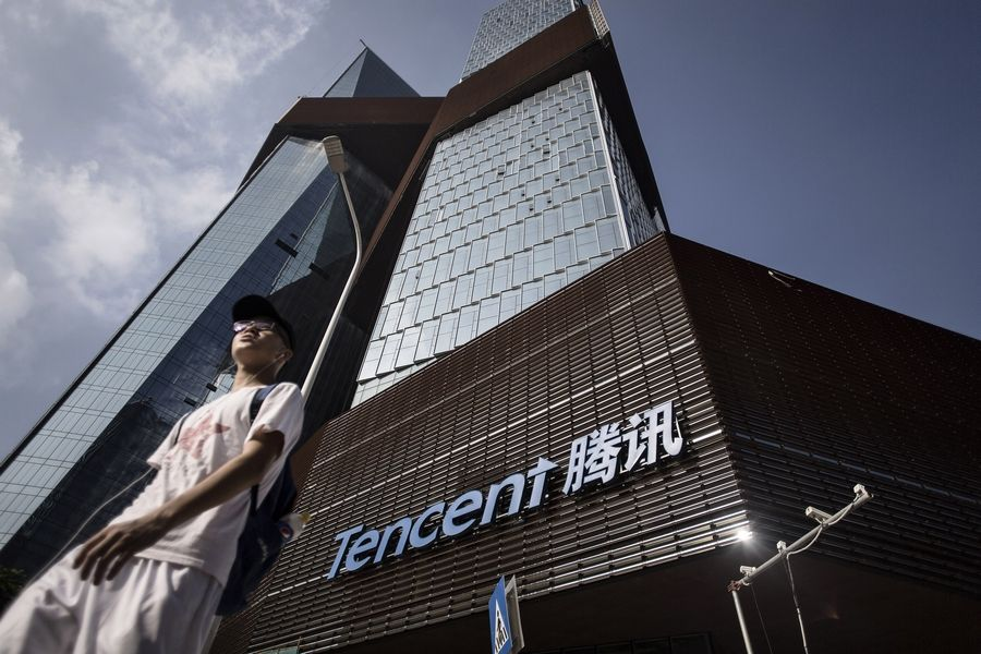 A pedestrian passes the headquarters for Tencent Holdings, a Chinese conglomerate whose subsidiaries specialize in Internet-related services and products.