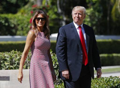 President Donald Trump and first lady Melania Trump arrive for Easter services at Episcopal Church of Bethesda-by-the-Sea in Palm Beach, Fla., Sunday, April 1, 2018.