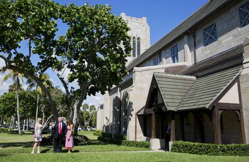 President Donald Trump stops to talk to members of the media as he arrives for Easter services with his daughter Tiffany Trump, left, and first lady Melania Trump at Episcopal Church of Bethesda-by-the-Sea, Sunday, April 1, 2018, in Palm Beach, Fla.