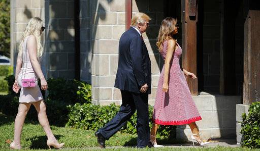 President Donald Trump, center, first lady Melania Trump, right, and Tiffany Trump, left, arrive for Easter services at Episcopal Church of Bethesda-by-the-Sea in Palm Beach, Fla., Sunday, April 1, 2018.