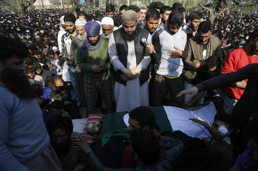 Kashmiri villagers offer funeral prayers near the body of Zubar Ahmad, one of the killed rebels at Shopian, south of Srinagar, India, Sunday, April 1, 2018. Deadly protests against Indian rule erupted in several parts of Indian-controlled Kashmir on Sunday following the killings of at least eight rebels in fighting with government forces, officials said. At least two army soldiers were also killed in the fighting.