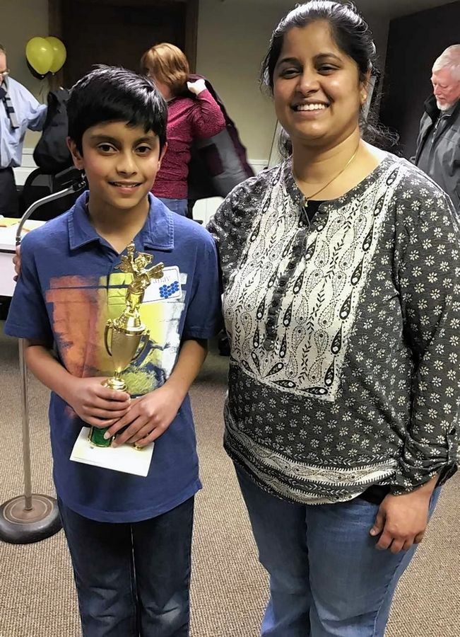 Pranav Kollu, 11, of Algonquin, with his mother Lakshmi Tadi, after recently becoming Kane County's champion speller. The fifth-grader at Cambridge Lakes Charter School in Pingree Grove is among seven suburban students who will be competing in the Scripps National Spelling Bee May 27 to June 1 in Washington, D.C.