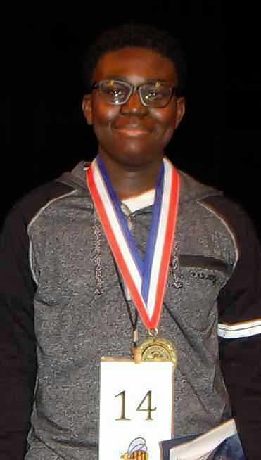 "Gabriel Ennin, 14, an eighth-grader at Heritage Grove Middle School in Plainfield, won Will County's regional spelling bee by correctly spelling ""epigraphic."" He is headed to the national spelling bee along with six other suburban contestants."