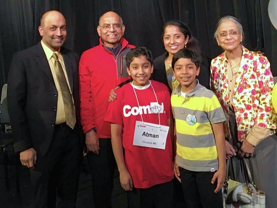 Atman Balakrishnan, 11, a sixth-grader from Hinsdale Middle School, won the DuPage County bee. His father, Balu Natarajan, far left, is the 1985 national spelling bee champion. Atman is accompanied here by his mother, Meenakshi, center, grandparents, Janaky, far right, and Chanda Natarajan, second from left, and younger brother, Advaith, 9.