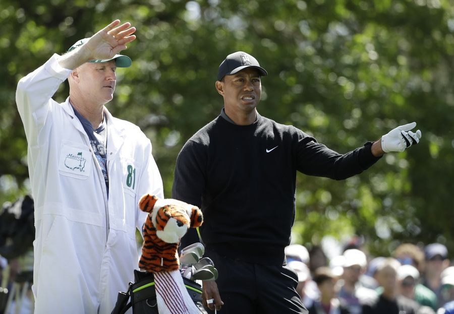 Tiger Woods looks over a shot on the fourth hole during the first round at the Masters golf tournament Thursday, April 5, 2018, in Augusta, Ga.