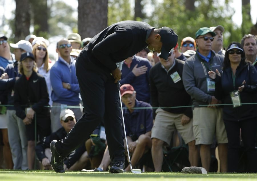 Tiger Woods reacts to a shot on the fourth hole during the first round at the Masters golf tournament Thursday, April 5, 2018, in Augusta, Ga.