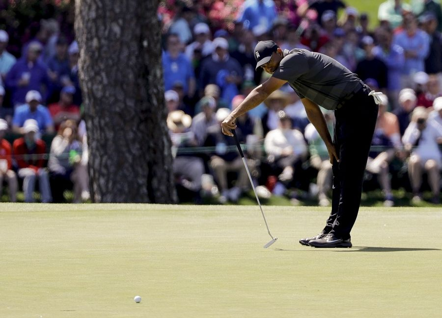 Tiger Woods misses a birdie putt on the 15th hole during the first round at the Masters golf tournament Thursday, April 5, 2018, in Augusta, Ga.