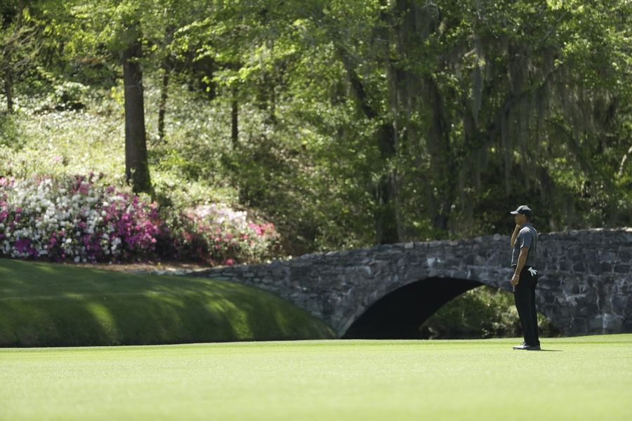 Tiger Woods looks for a drop on the 12th hole during the first round at the Masters golf tournament Thursday, April 5, 2018, in Augusta, Ga.