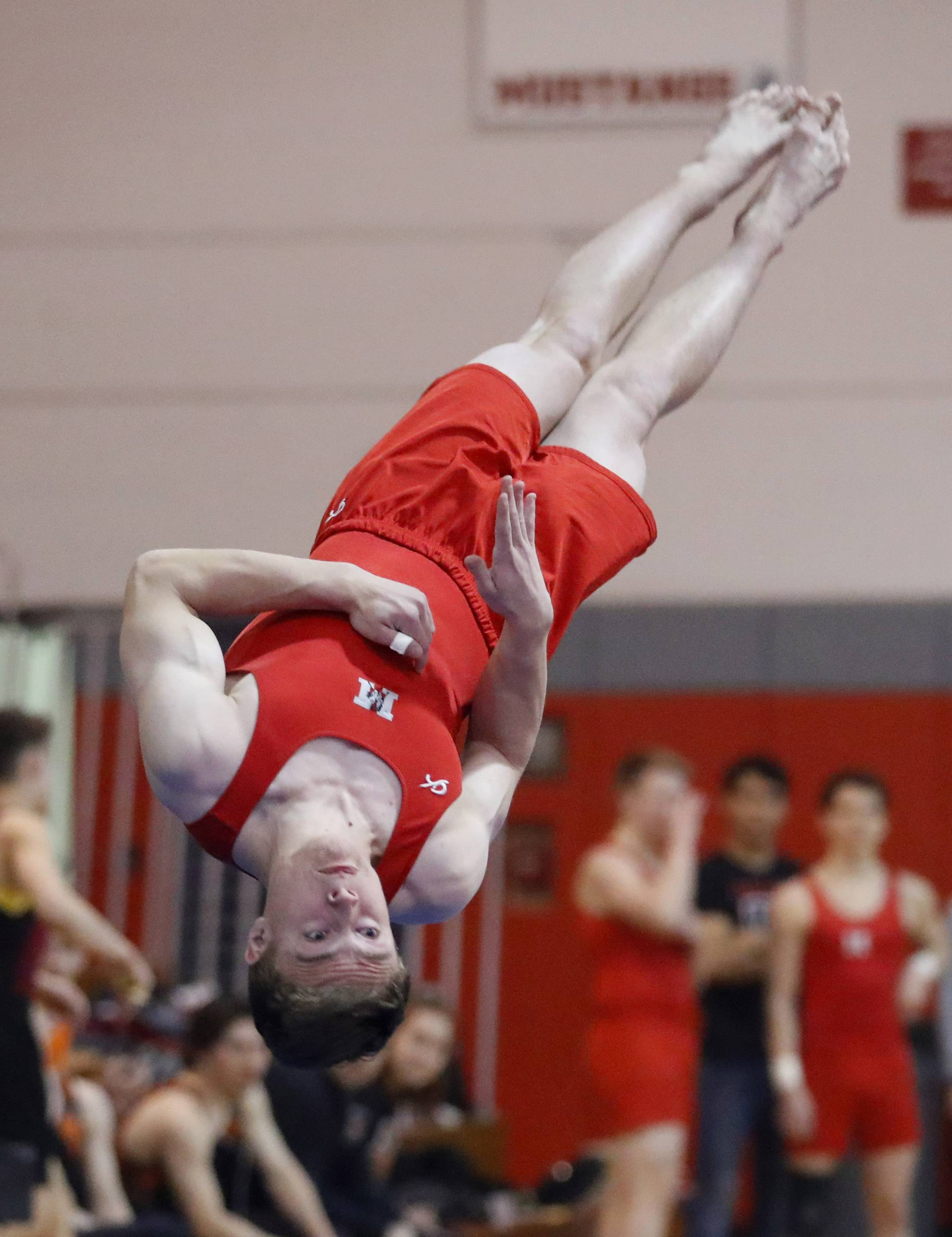 Mundelein's Will Ferro competes on the floor exercise during the Bob Bohl invite at Mundelein on Friday night.