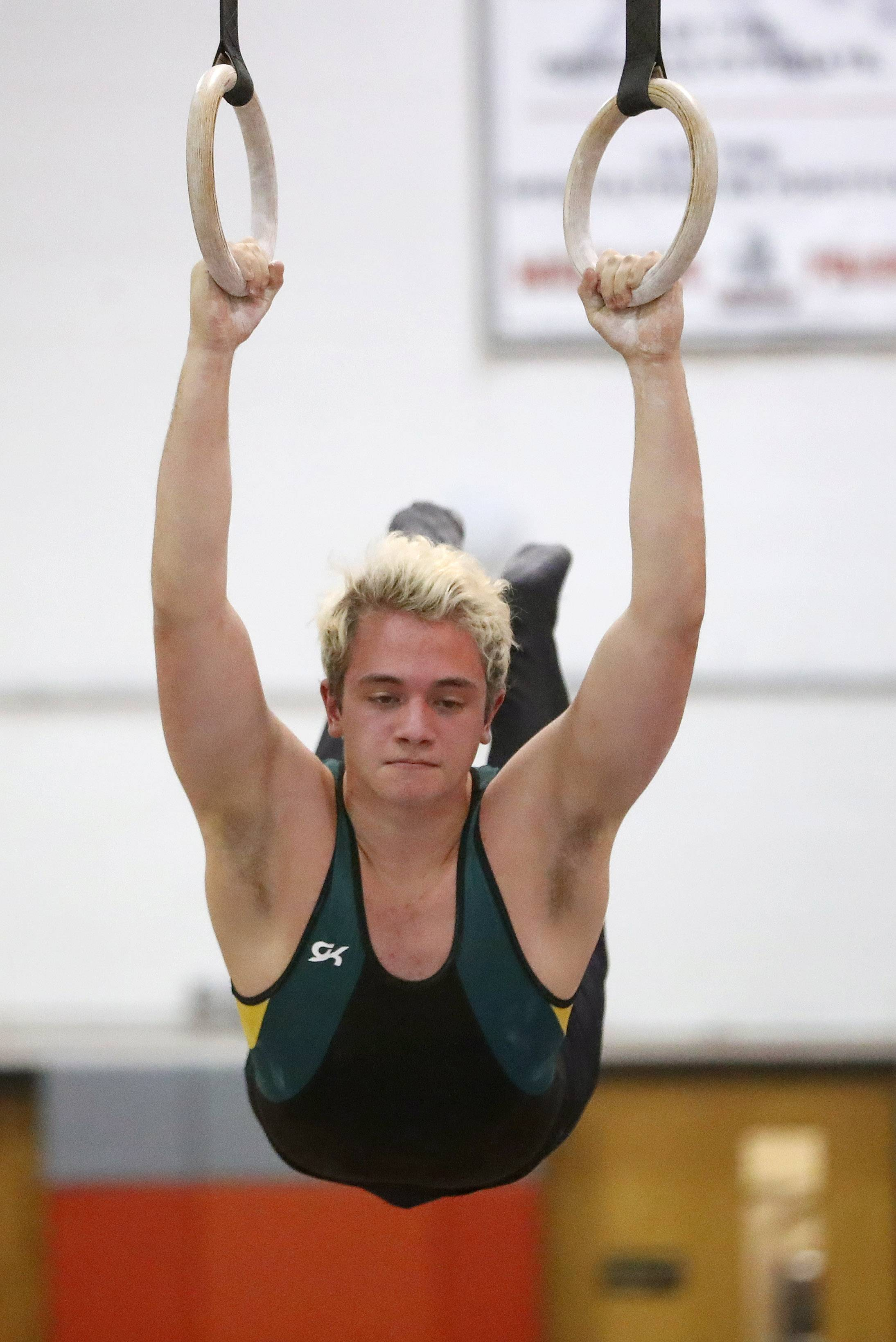 Stevenson's Danny Less competes on the still rings during the Bob Bohl invite at Mundelein on Friday night.