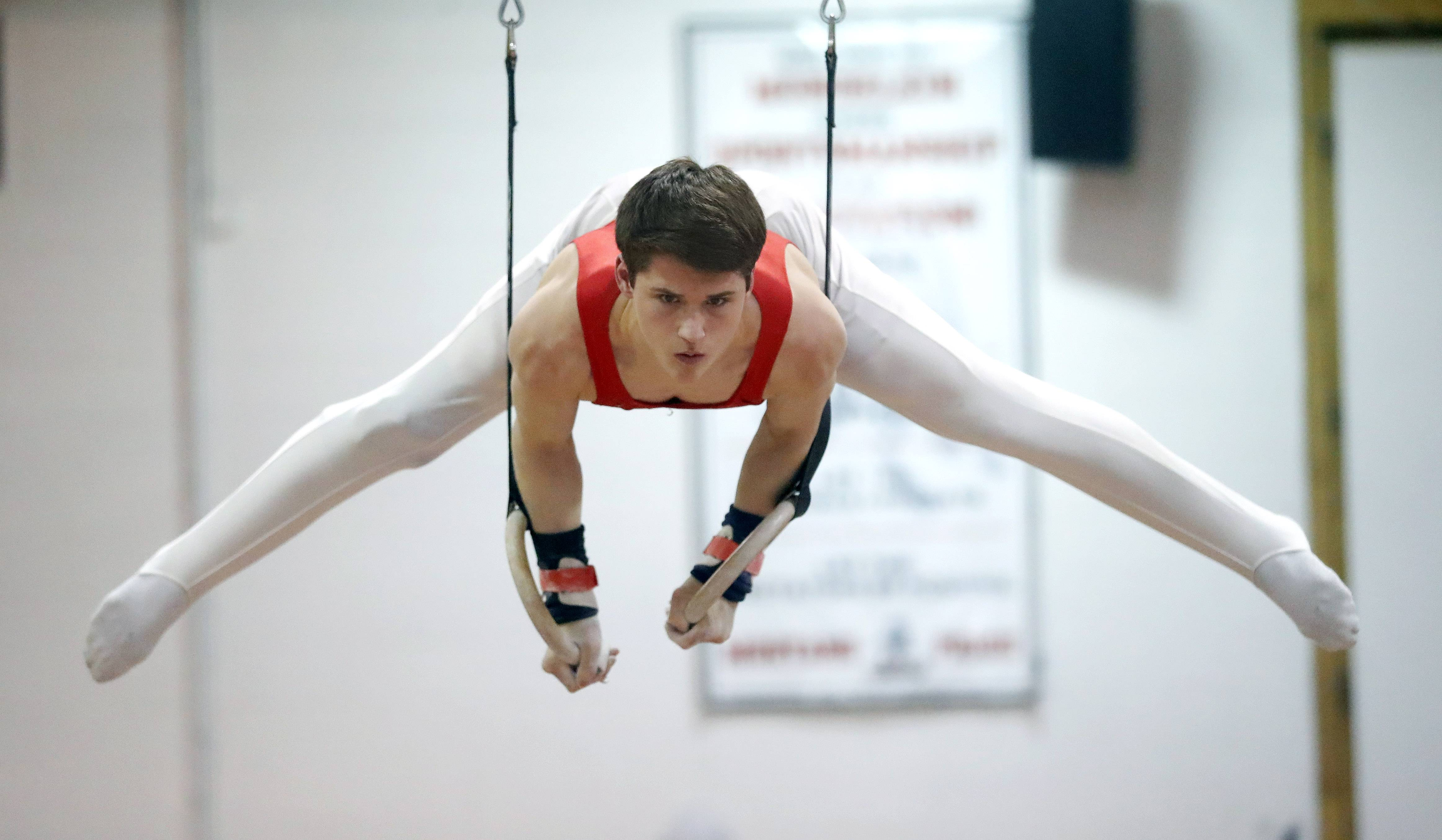 Mundelein's Kurt Lawrence competes on the still rings during the Bob Bohl invite at Mundelein on Friday night.