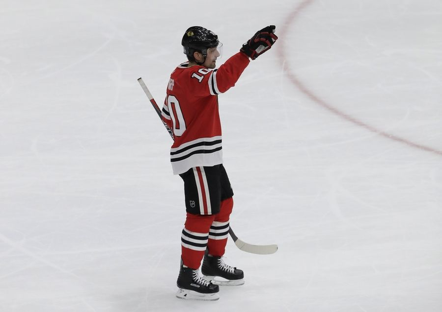 Chicago Blackhawks left wing Patrick Sharp waves to the crowd as he is honored on the scoreboard during the third period of an NHL hockey game against the St. Louis Blues, Friday, April 6, 2018, in Chicago.