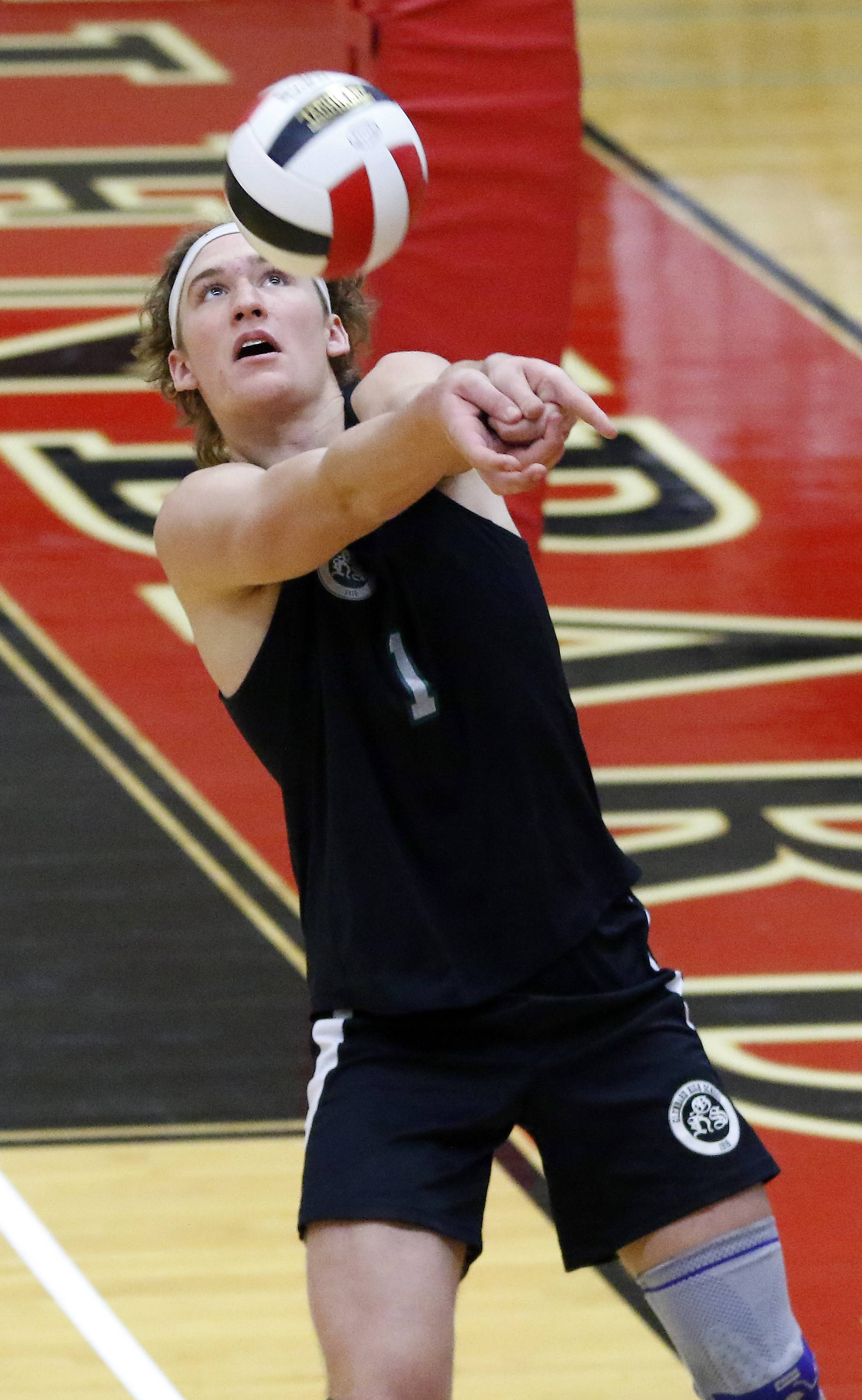Glenbard West's Ben Harrington, returns a Lake Park shot during the Springfest boys volleyball tournament Saturday at Glenbard East High School in Lombard.