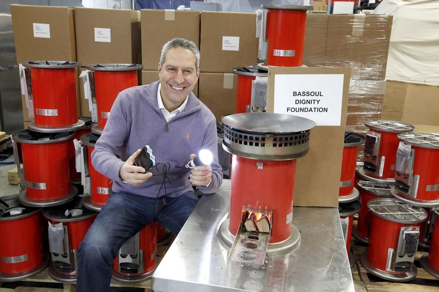 Selim Bassoul, CEO at Middleby in Elgin, is surrounded by some of the ovens that he is sending to Haiti and Puerto Rico.