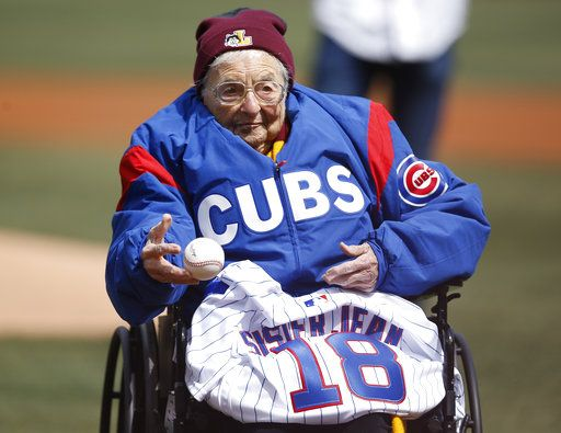 Loyola University Chicago's Sister Jean throws out a ceremonial pitch prior to the start of the Cubs' home opening baseball game against the Pittsburgh Pirates Tuesday, April 10, 2018, in Chicago.