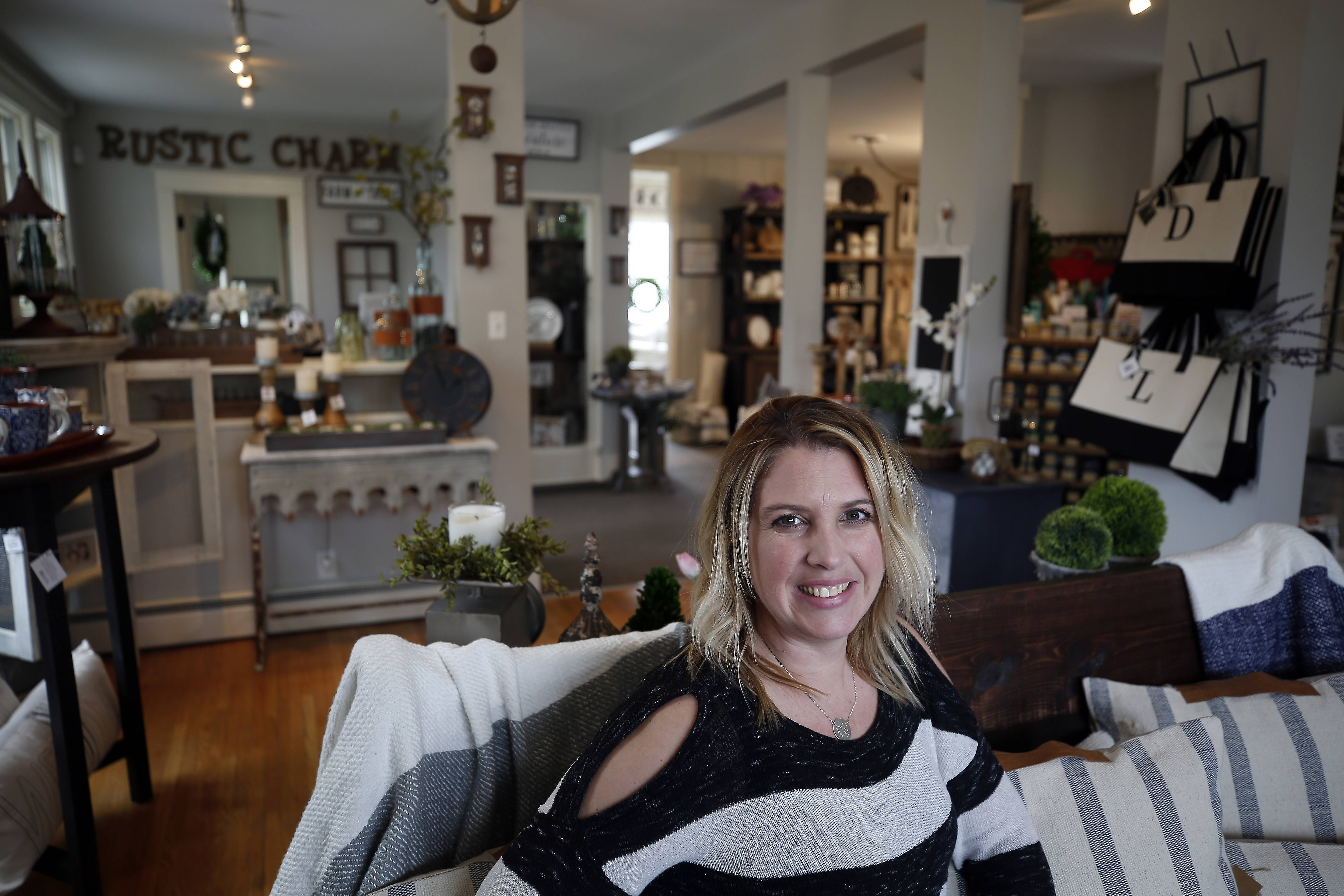 Kelly Volz is co-owner of Rustic Charm in downtown Geneva, a store that sells hand-picked home decor and furniture.
