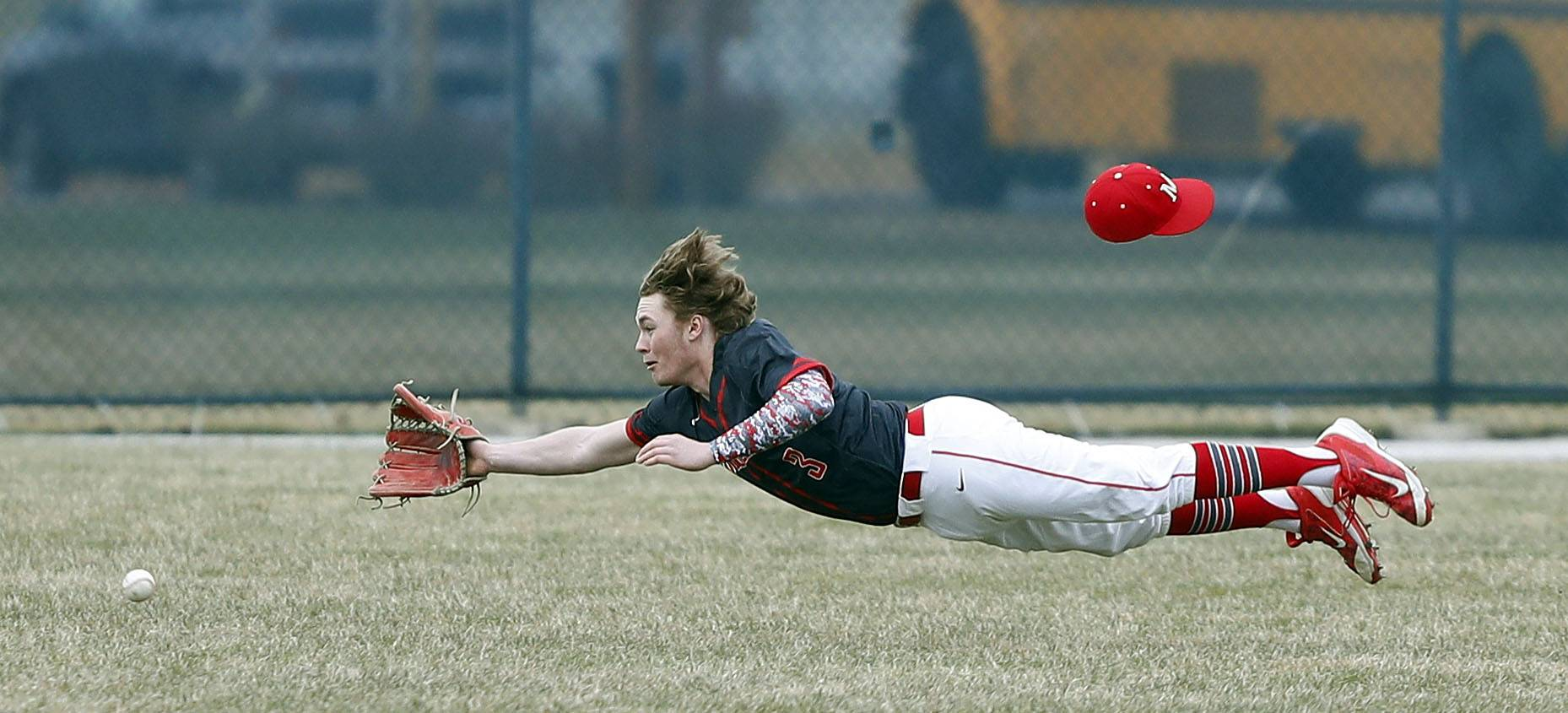Mundelein's Jeff Morton makes a diving attempt at a flyball against Stevenson on Wednesday in Lincolnshire.