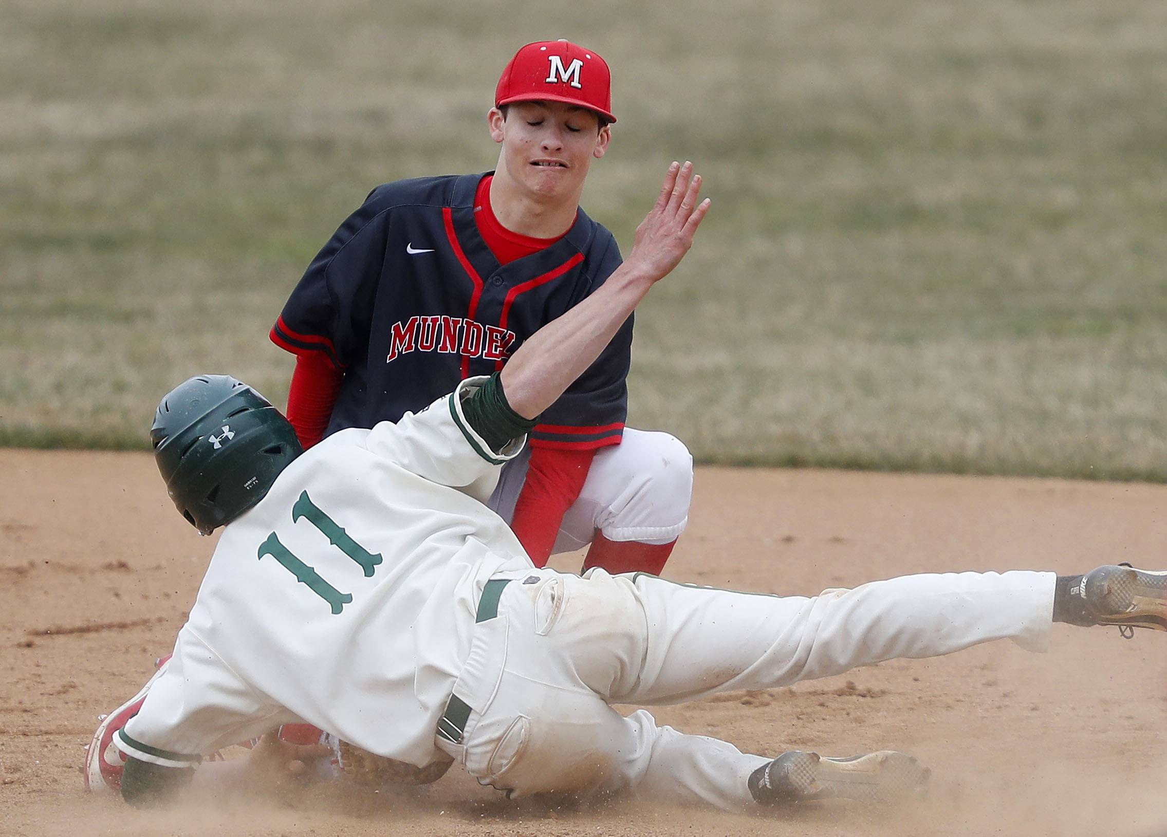Stevenson's Jack Housinger (11) gets caught stealing as Mundelein's Andrew Schroeder makes the tag Wednesday in Lincolnshire.