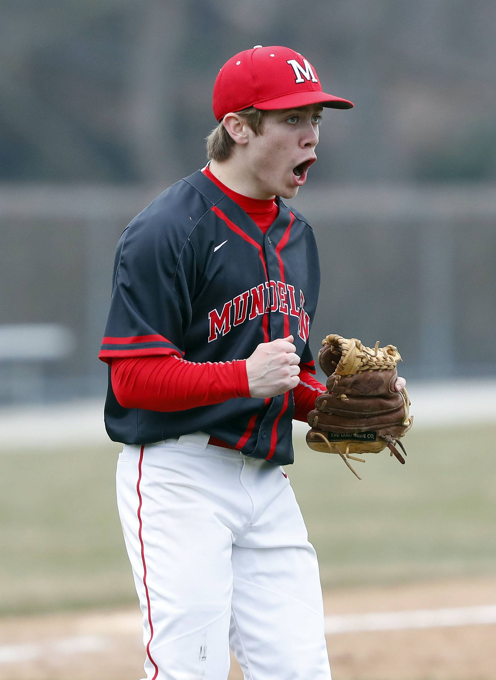 Mundelein pitcher Austin Greco argues a call against Stevenson on Wednesday in Lincolnshire.