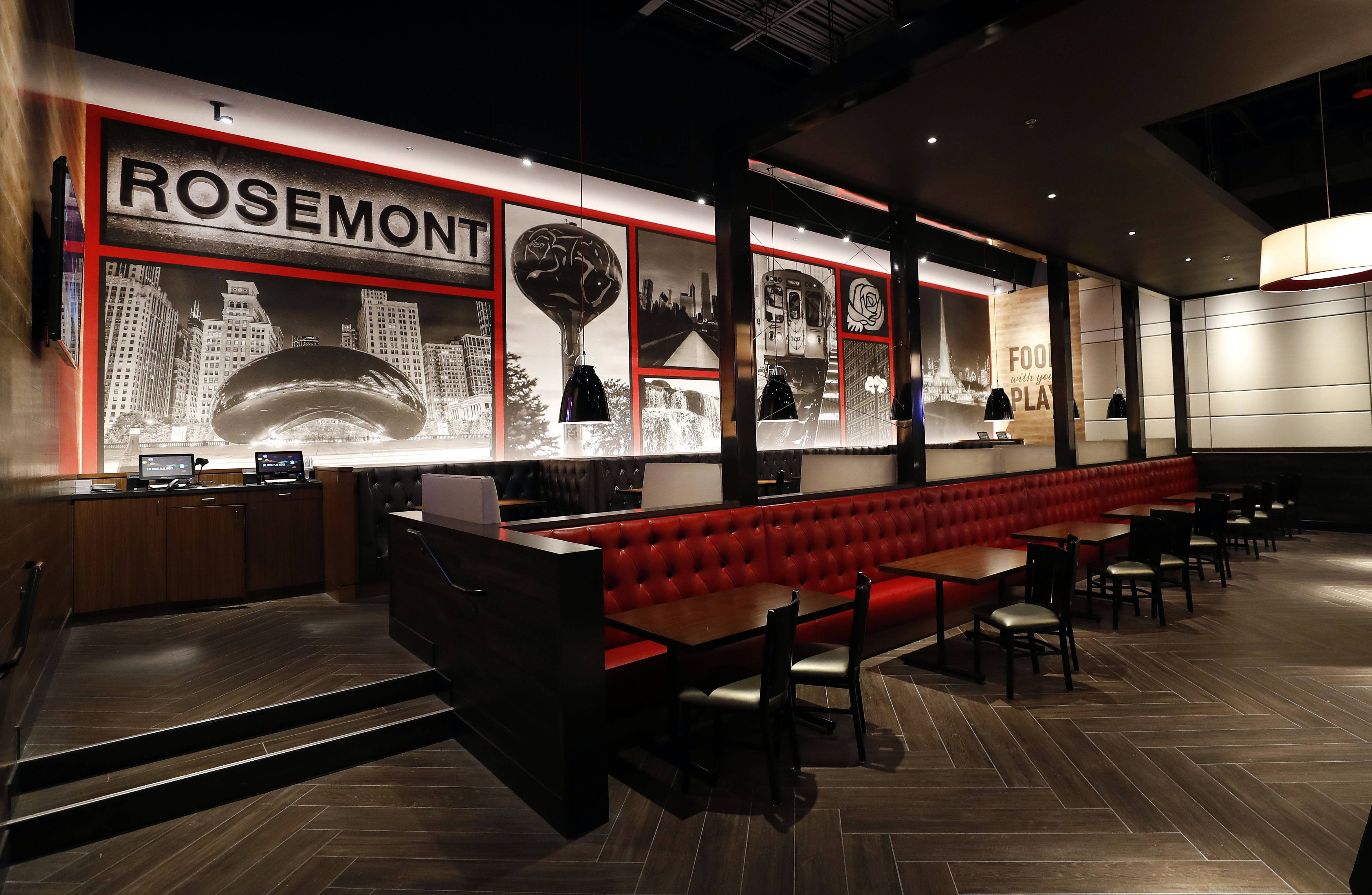 The dining room at the new Dave & Buster's location in Rosemont features murals of Rosemont and Chicago scenery.