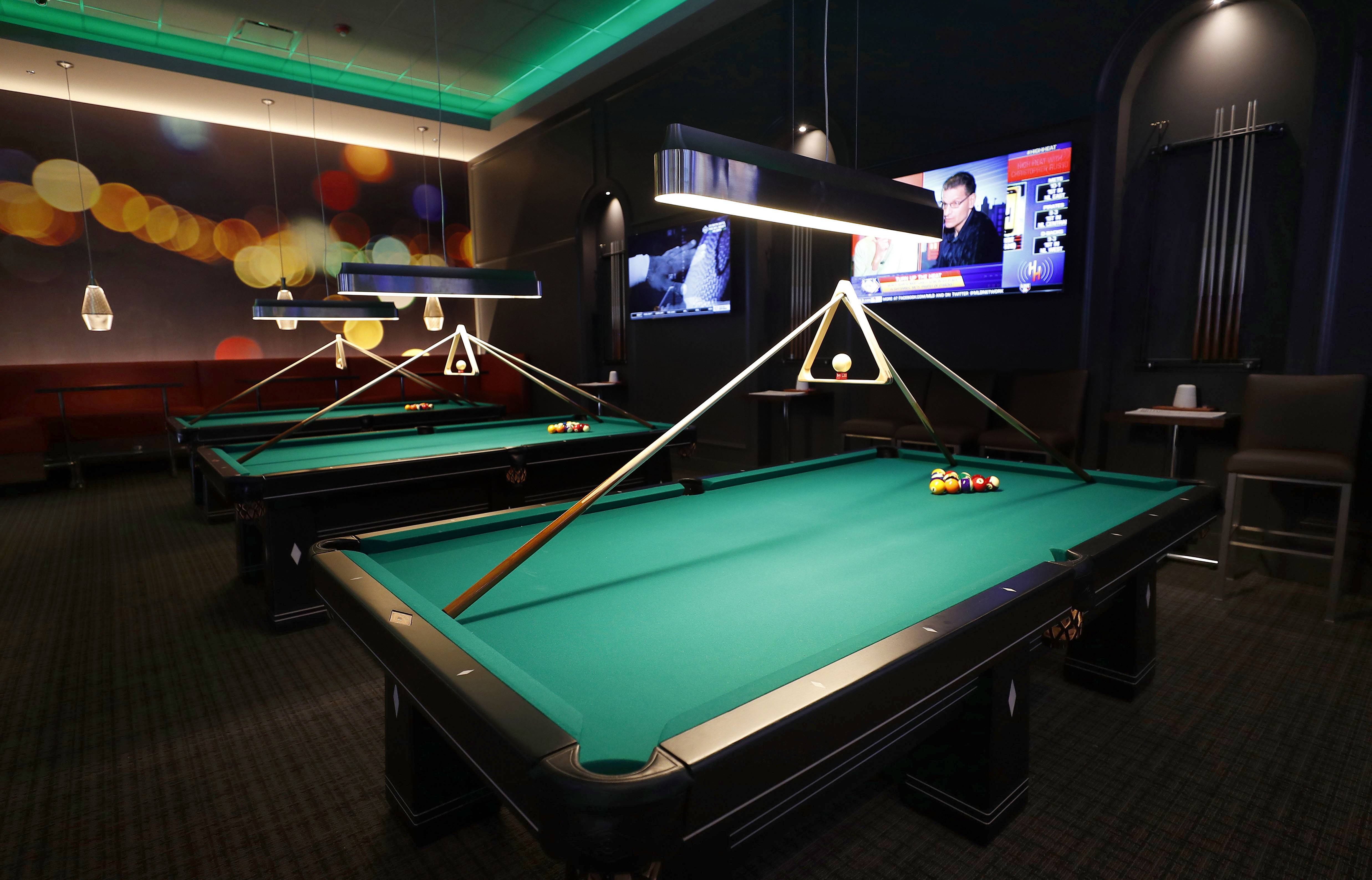 The billiards room at the new Dave & Buster's in Rosemont has three pool tables -- uniquely designed for the Dallas-based chain.