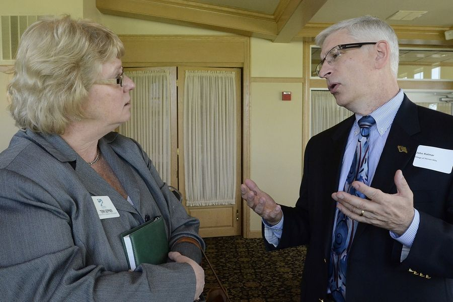 "Terri Gepner of Pathway Senior Living in Vernon Hills talks with Vernon Hills Village Manager John Kalmar after an ""Ask the Mayors"" luncheon."